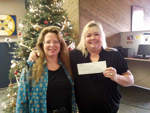 Accepting a donation from Sue Geremia with Pacific Crest Federal Credit Union